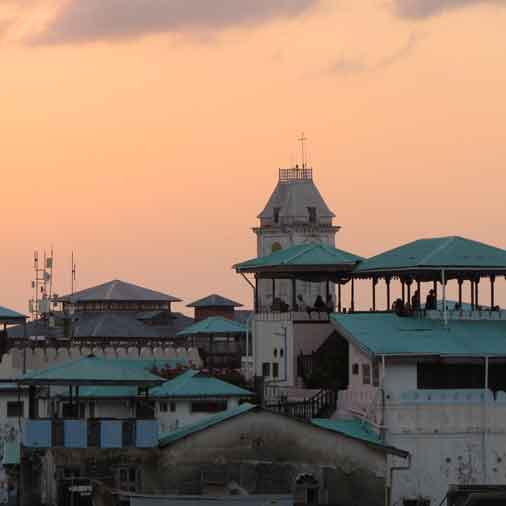 Sunset view over the roofs when having dinner in Stone Town during the 10 days cycling tour around Zanzibar